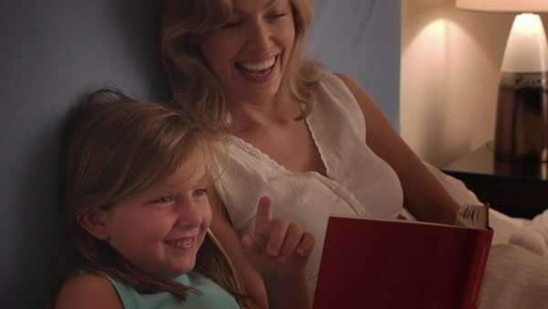Mother and daughter reading in bed. Royalty-free stock video