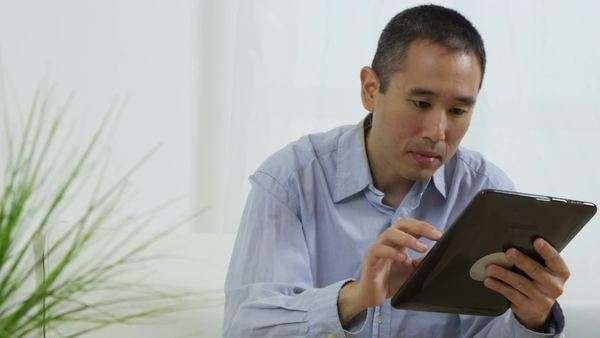 Portrait of Asian man with digital tablet Royalty-free stock video