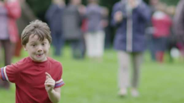 A 6-year-old school boy running during a sports event, slow motion Royalty-free stock video
