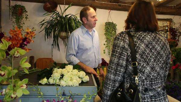 Customer browsing a selection of flowers Royalty-free stock video