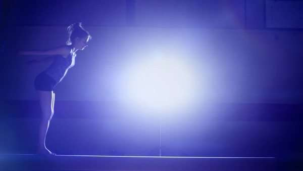 Female gymnast peforming on a balance beam in slow motion Royalty-free stock video