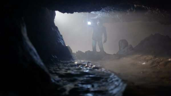 Explorer enters cave looking for treasure Royalty-free stock video