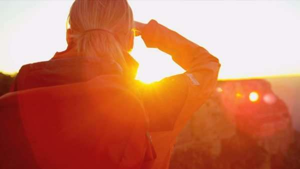 Lone female hiker watching the sun setting over the canyons, USA, Shot on Red Epic Royalty-free stock video