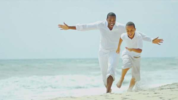 Closeness of ethnic lucky parent spending summer vacation together son by ocean shot on RED EPIC Royalty-free stock video