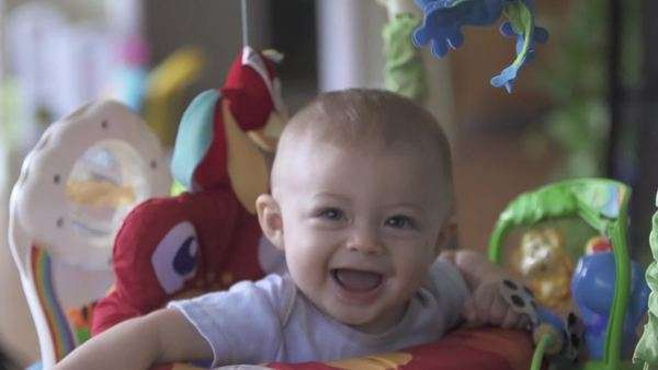 Slow motion of cute baby in jolly jumper. Royalty-free stock video