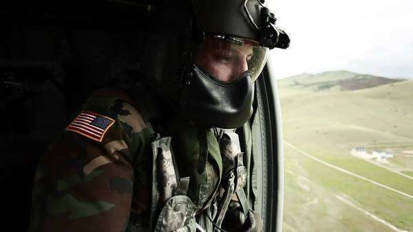 Soldier looking out side door of Black Hawk helicopter. Green Beret United States Army Special Forces. Royalty-free stock video