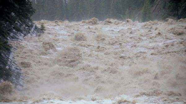Close up raging swollen river flood waters creating damage environmentally Royalty-free stock video