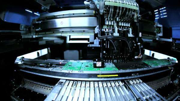 Close up of automated machine manufacturing PCBs operated by Chinese worker, Mainland China, East Asia Royalty-free stock video