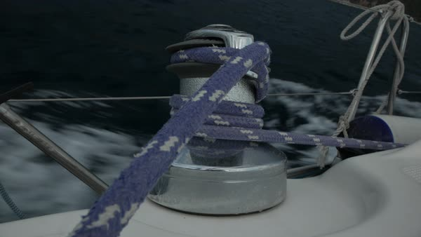 Close-up of steel sailboat winch with rope on the deck during yacht sailing  stock footage