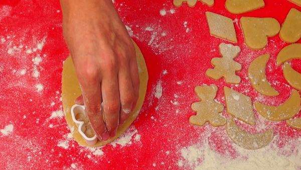 Woman's hands cutting Christmas cookies from dough Royalty-free stock video