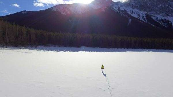Aerial shot of a person walking in the mountains Royalty-free stock video