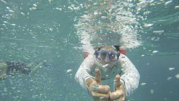 Portrait of woman gesturing while snorkeling in sea Royalty-free stock video