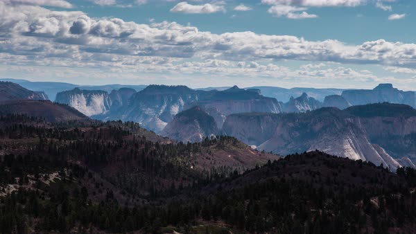 Clouds move over Zion canyon as seen from a lookout far away. Royalty-free stock video