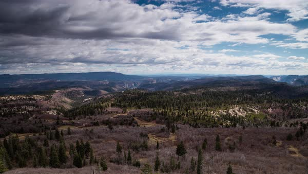 Clouds move over the Zion plain as seen from a lookout far away. Royalty-free stock video