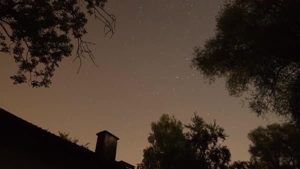 Stars fly over a rural house at night. Royalty-free stock video