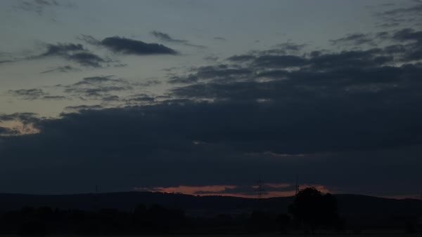 Sunrise over a range of hills near Walldorf, Germany. Royalty-free stock video