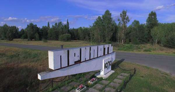 Entrance sign to the now-abandoned Ukraine city of Pripyat near Chernobyl  stock footage