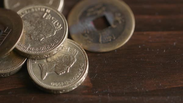 Close-up shot of Chinese coins on a tabletop stock footage
