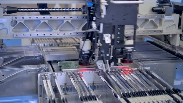 A single beam surface mount technology (SMT) machine at work  stock footage