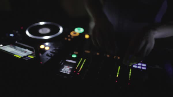 Hand-held shot of a DJ at his console Royalty-free stock video