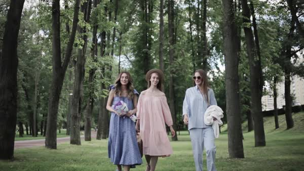 Wide shot of women walking in a park Royalty-free stock video