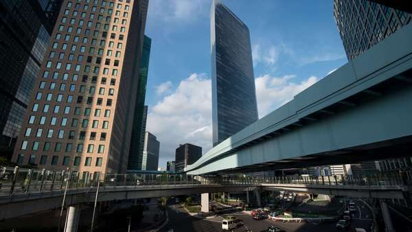 Timelapse pan-up view of Shiodome business district and Yurikamome line, Tokyo, Japan Royalty-free stock video