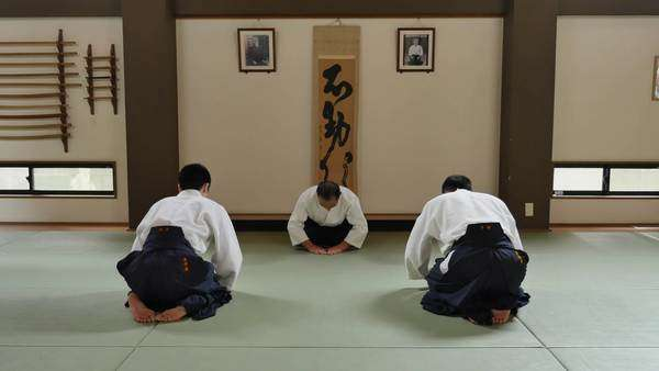 Aikido Athletes Bowing In A Traditional Dojo Stock Video Footage