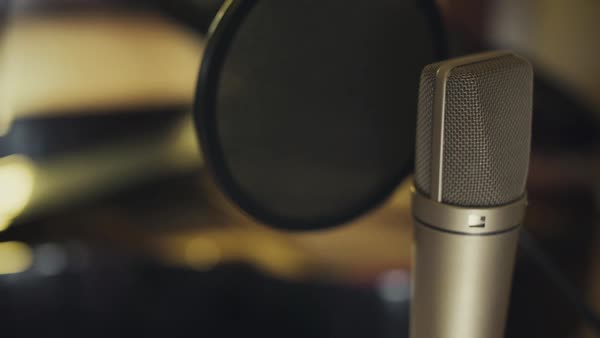 Close-up panning shot of a microphone indoors Royalty-free stock video