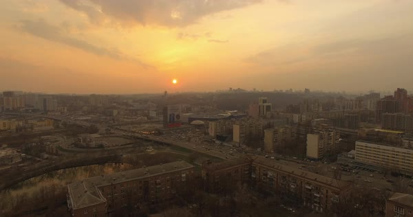 Aerial shot of sunrise over a city in Ukraine at sunset Royalty-free stock video