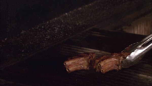 Montage of a chef cooking grilled rack of lamb in the kitchen Rights-managed stock video