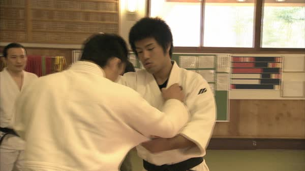 Hand-held shot of judo fighters practicing in a dojo in Kanagawa Rights-managed stock video