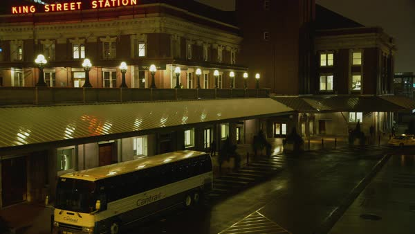 Locked-off shot of King Street Station building at night in Seattle Rights-managed stock video