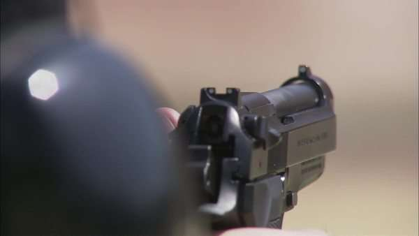 Close-up shot of a person shooting with a gun Rights-managed stock video