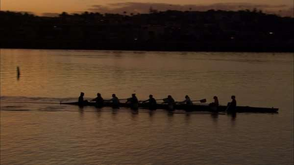 Tracking shot of women rowing at sunset Rights-managed stock video