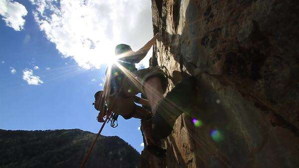 Slow motion of a man rock climbing in Sun Valley, Idaho Rights-managed stock video