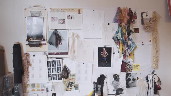 Push-out shot of fashion sketches pinned to a wall Royalty-free stock video