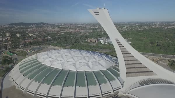 Aerial shot Olympic Stadium overlooking downtown camera moving closer stock  footage