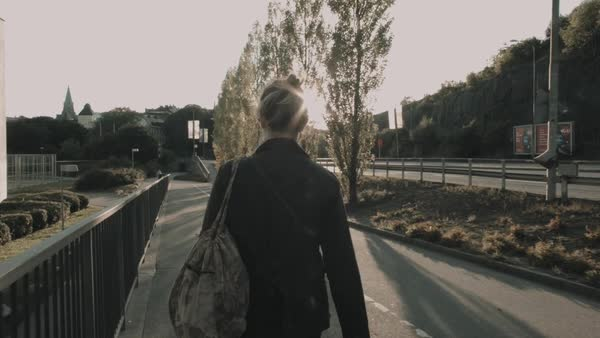 Tracking shot of a woman walking on a street Royalty-free stock video