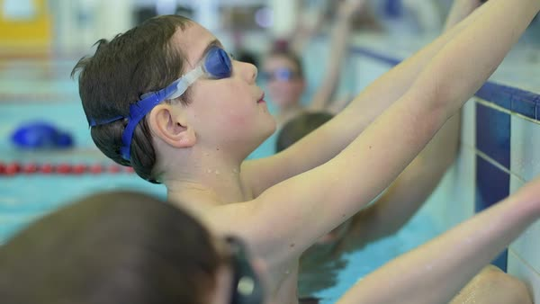 Close-up of young sportive school boy in swimming pool during training Royalty-free stock video