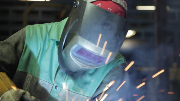 Close up worker welding in a US manufacturing plant. Royalty-free stock video