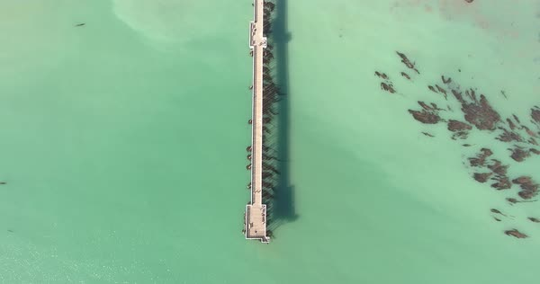 Rising aerial shot of pier with water. Royalty-free stock video