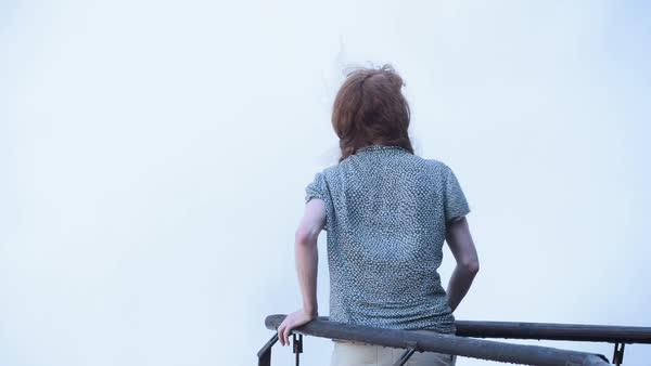 Hand-held shot of a woman standing by a waterfall Royalty-free stock video