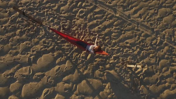 Drone shot of a woman lying in a hammock Royalty-free stock video