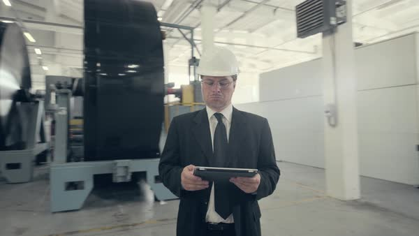 Businessman using tablet pc at manufacturing plant Royalty-free stock video