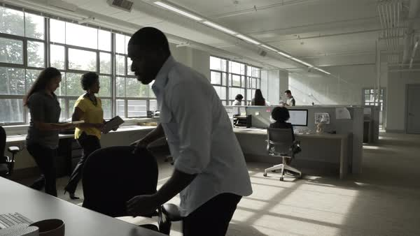 Hand-held shot view of two office colleagues discussing while walking through an modern office space Royalty-free stock video