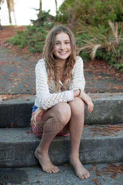 Barefoot Girl Sitting On Park Steps Stock Photo Dissolve