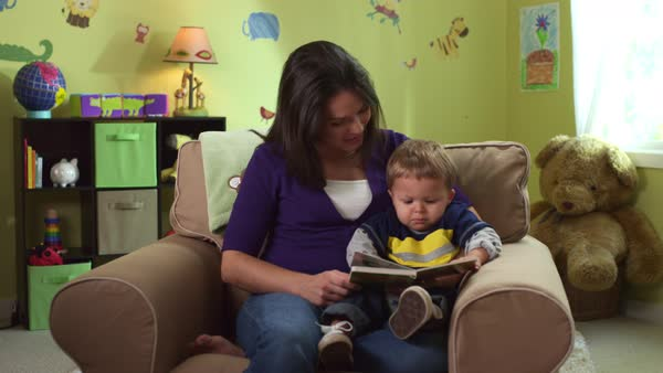 Mother reading to son in playroom Royalty-free stock video