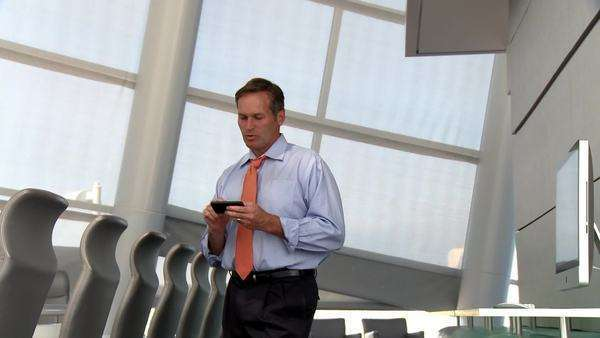 Caucasian businessman talking and texting on cell phone Royalty-free stock video