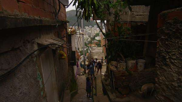 Slow motion dolly shot - turning a corner and going downstairs in a favela in Rio de Janeiro, Brazil Royalty-free stock video