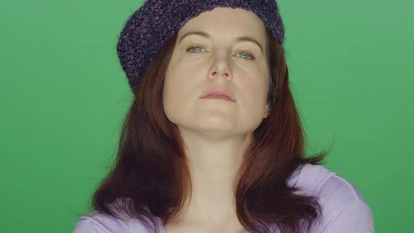 Young redhead woman wearing a beret posing and making seductive faces, on a green screen studio background Royalty-free stock video